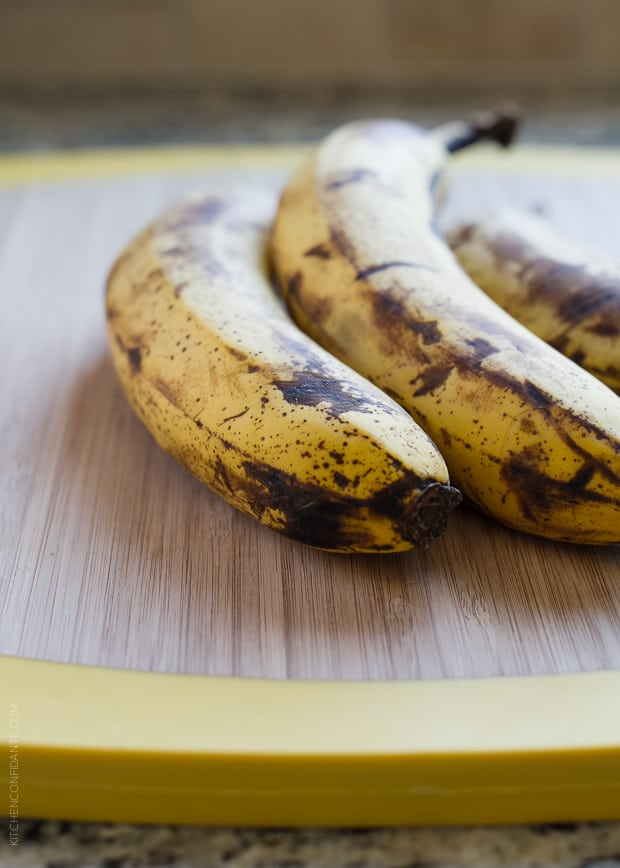 Ripe bananas on a wooden surface.