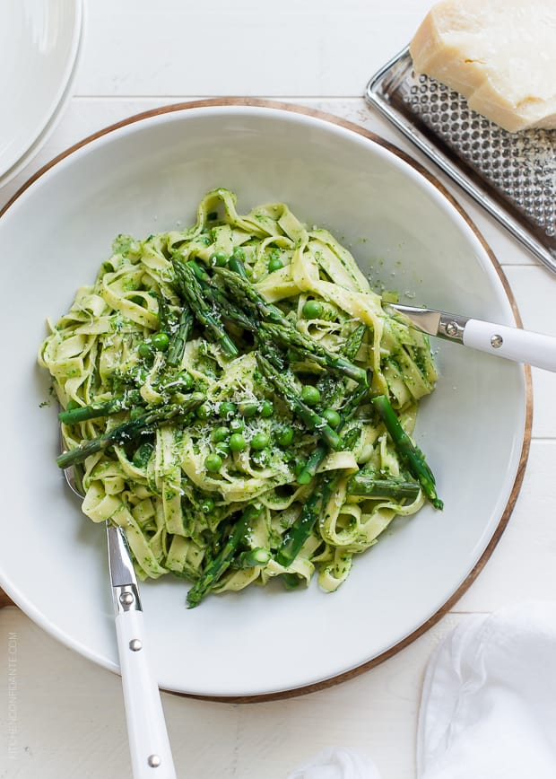 Fettuccine with Creamy Spinach Sauce, Asparagus and Peas in a white bowl.