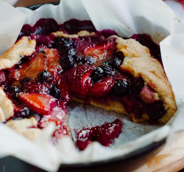 Mixed Berry Cornmeal Galette in a cast iron skillet.