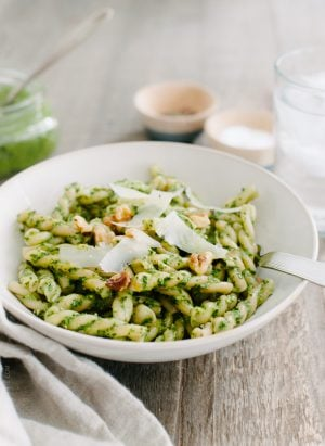 Swiss Chard Walnut Pesto Pasta in a white dish.