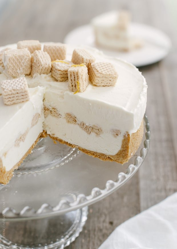 No-Churn Cheesecake Ice Cream Cake on a cake stand with slices removed.