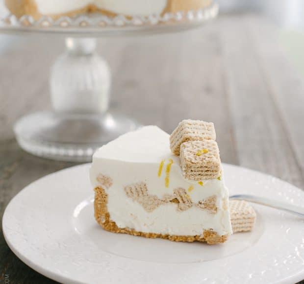 A slice of No-Churn Cheesecake Ice Cream Cake on a white plate.
