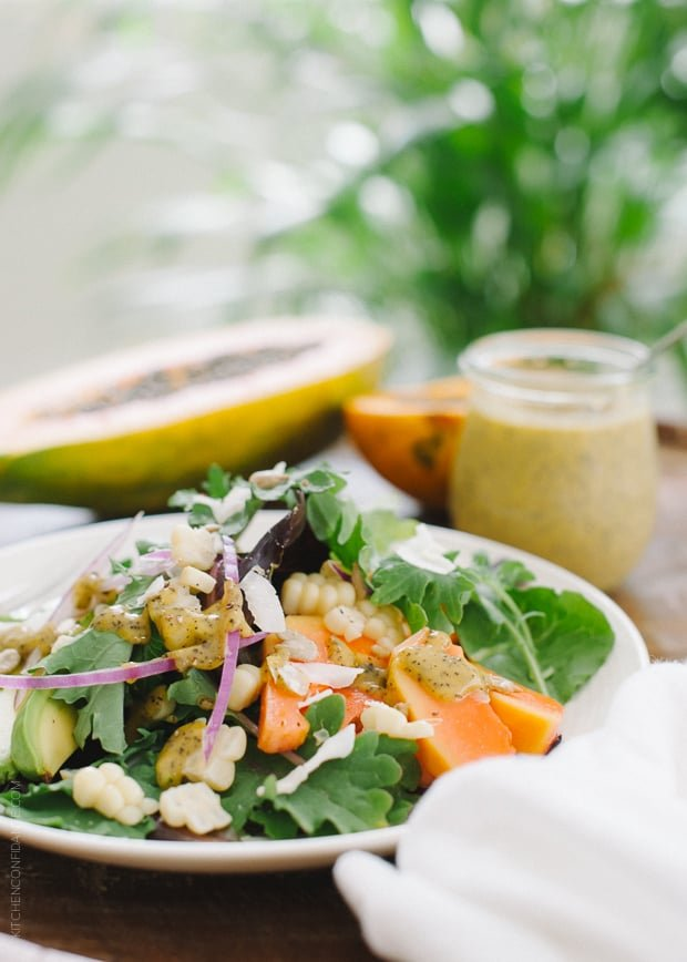 Papaya Seed Vinaigrette Dressing over a green salad.