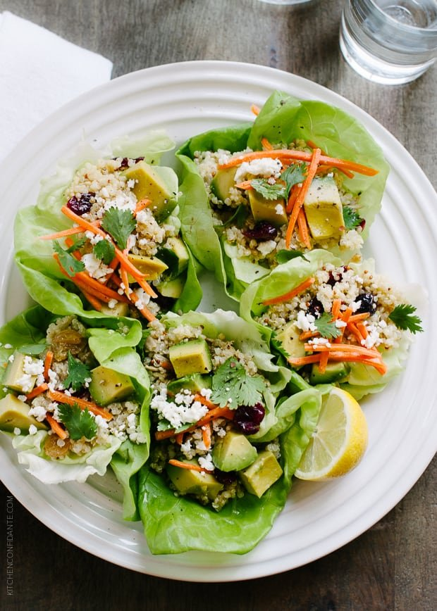Quinoa Salad Lettuce Cups filled with feta, avocado, and even dried cranberries.