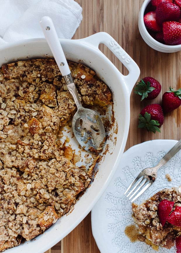 Baked Buttermilk French Toast with Oat Streusel in a white Staub casserole dish.