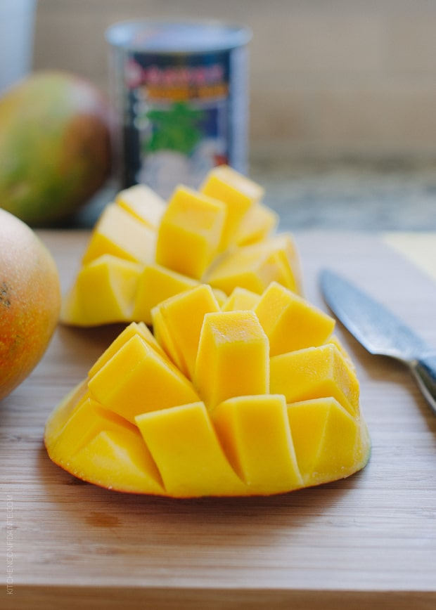 Fresh mangoes cut into sections.