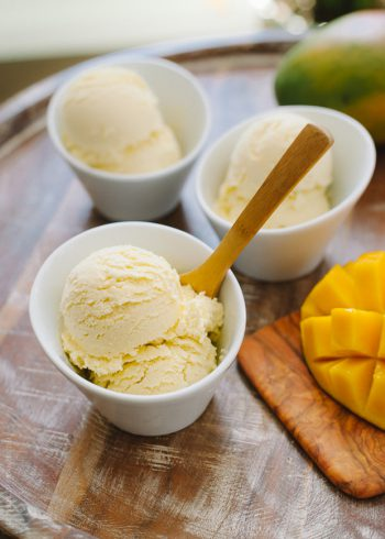 Scoops of healthier Dairy Free Mango Coconut Ice Cream in white bowls.