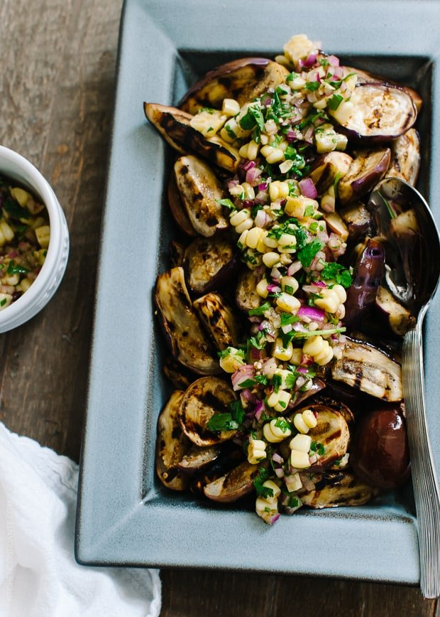 Grilled Eggplant with Corn Chimichurri in a serving dish.