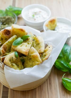 Pesto Baked Naan Chips | www.kitchenconfidante.com | Craving something crunchy? These oven baked chips crisp up in minutes, making them perfect for snack time and entertaining!