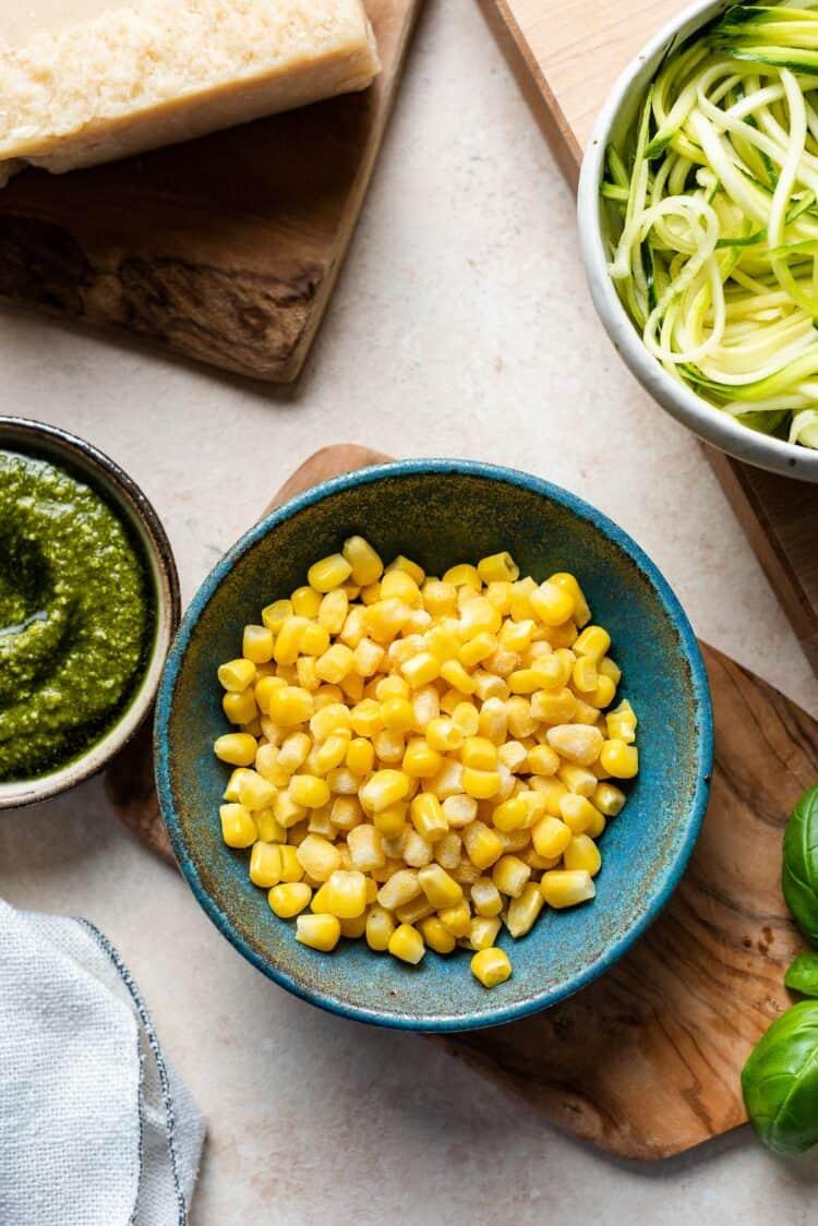 Corn kernels in a bowl for Zucchini, Corn and Pesto Flatbreads.