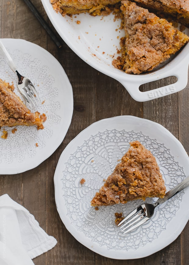 Slices of Buttered Rum and Candied Sweet Potato Crumb Cake on plates with forks.