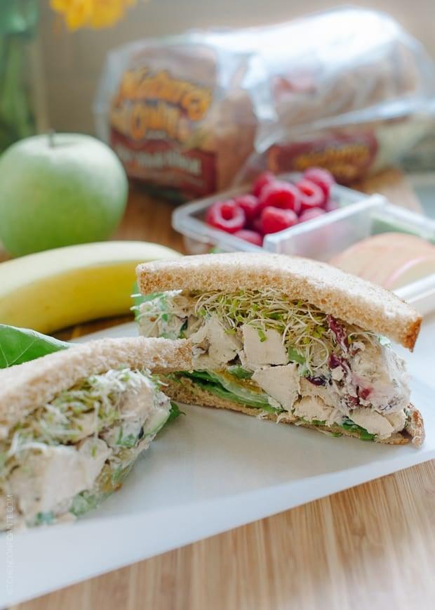 Green Apple Chicken Salad (Mayo Free) filling a sandwich.