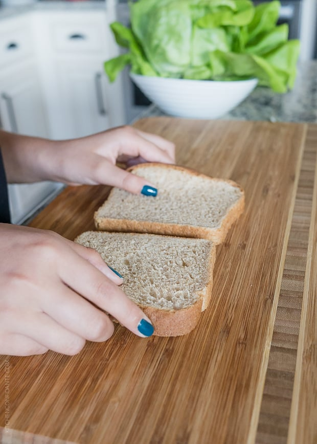 Preparing slices of bread for a chicken salad sandwiches.