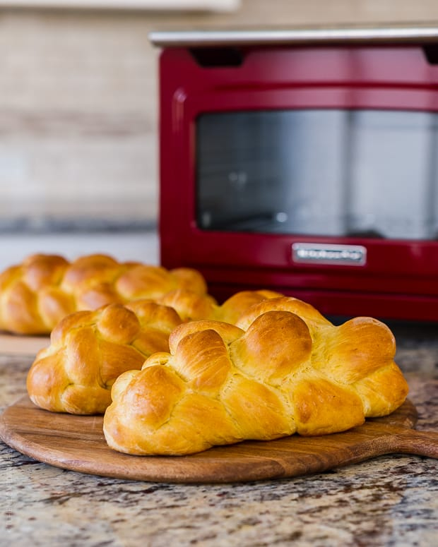 Loaves of Sweet Potato Challah on a counter top.