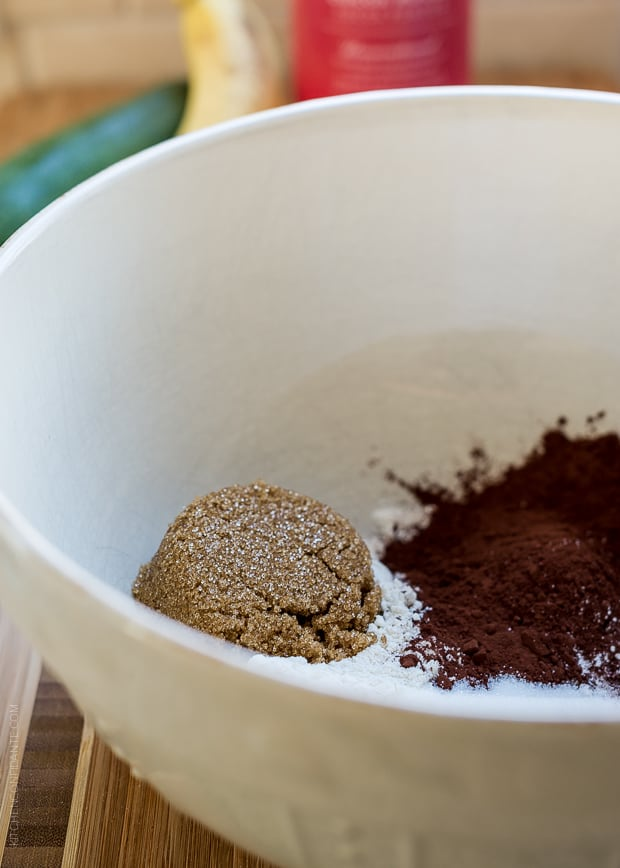 Dry ingredients for Zucchini Banana Brownies : sugar, flour, cocoa powder.