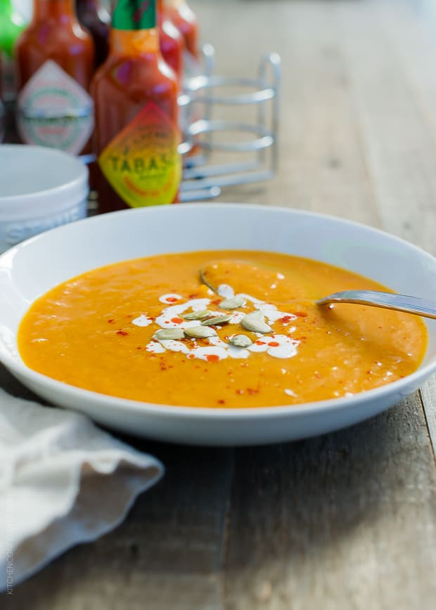Pumpkin Soup topped with pumpkin seeds.
