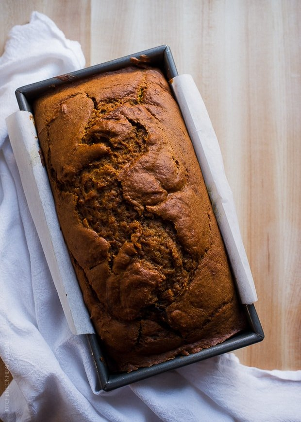 Chocolate Marble Pumpkin Bread in a loaf pan on a wooden counter top.