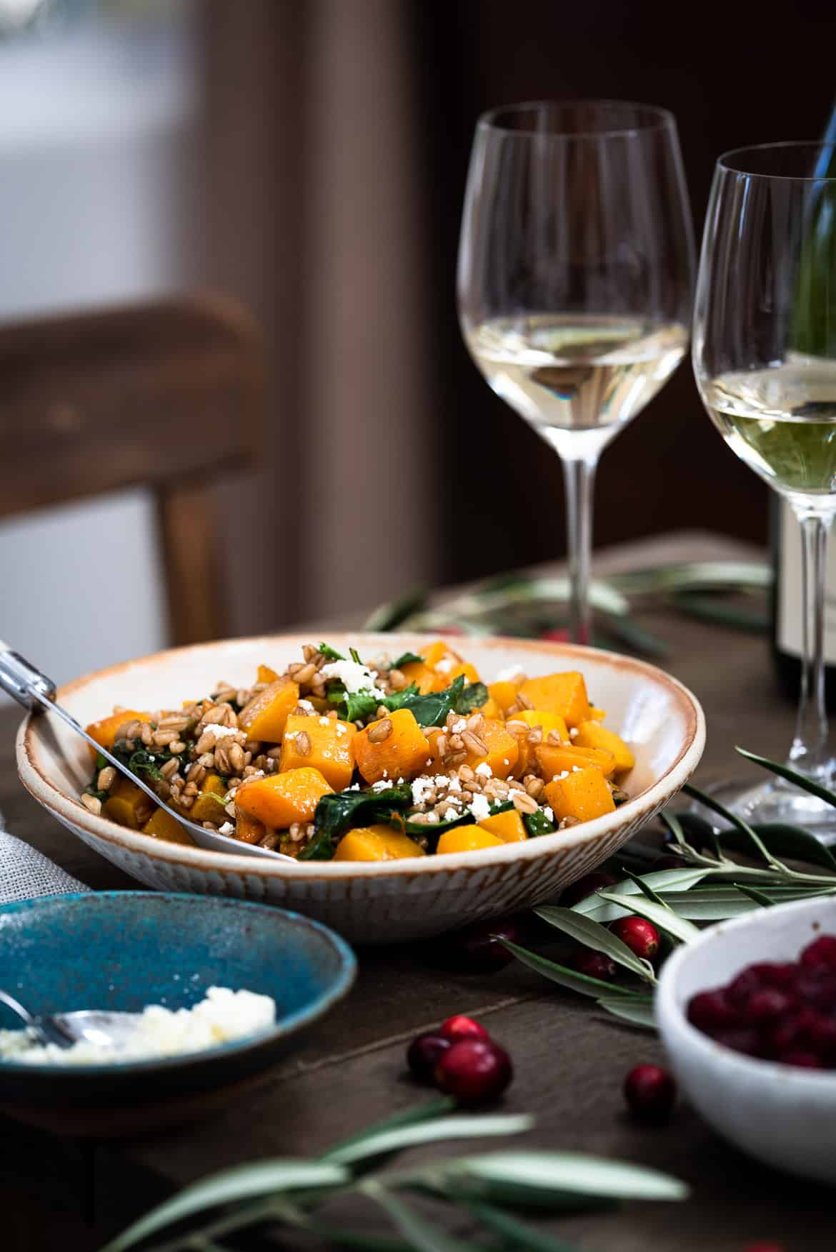 Roasted Butternut Squash Winter Salad in a white bowl.