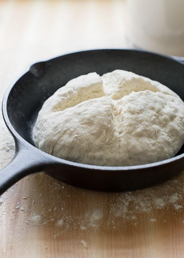 Cast iron skillet with Irish Soda Bread ready to bake.
