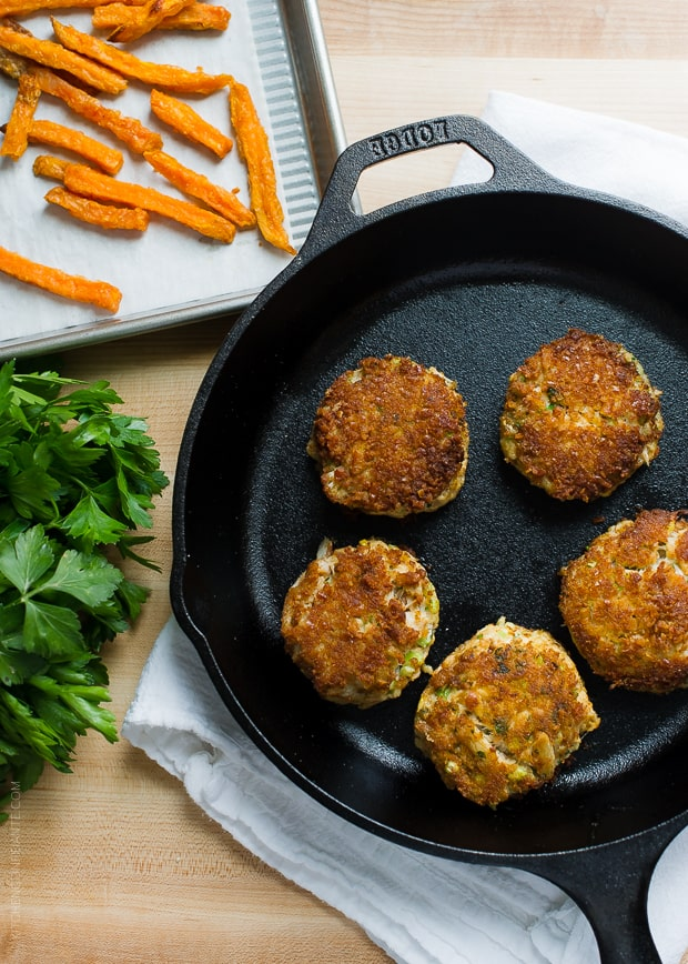 Pretzel Crusted Crab Cake Sliders in a cast iron skillet.