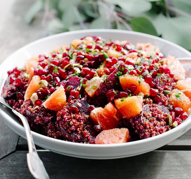 Quinoa Salad with Pomegranate Arils in a white salad bowl.