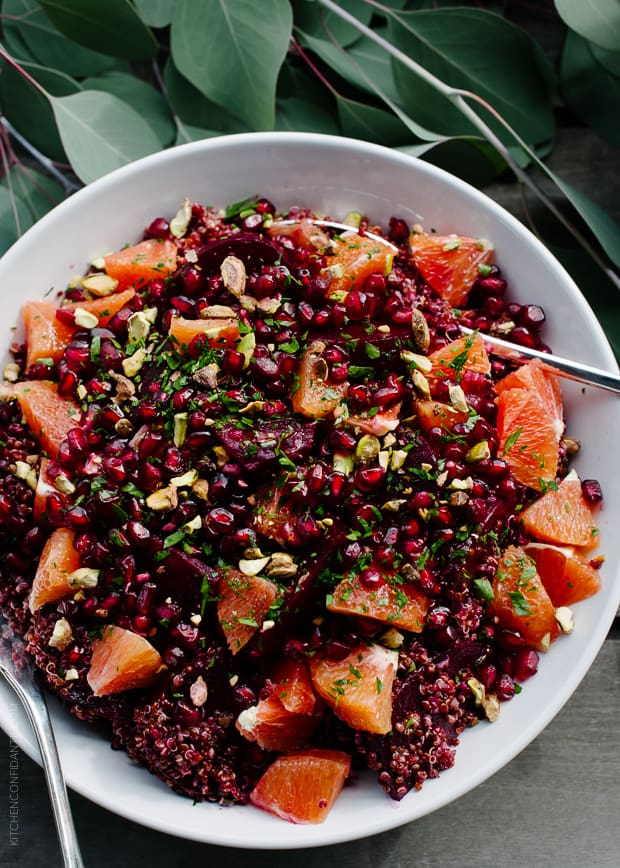 Quinoa Salad with Roasted Red Beets, Oranges and Pomegranate in a serving bowl.