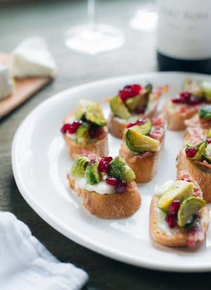 Roasted Brussels Sprouts with Bacon Crostini arranged on a white serving platter.