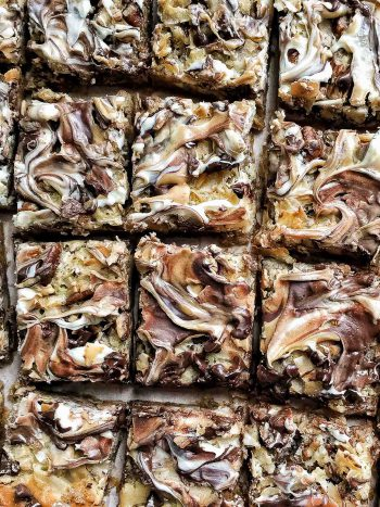 Close up view of a pan of freshly baked 7 Layer Bars.
