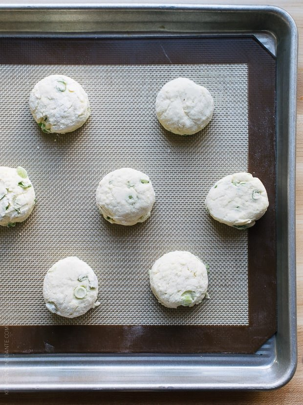 Cream Cheese and Green Onion Biscuits on a baking sheet ready for the oven.