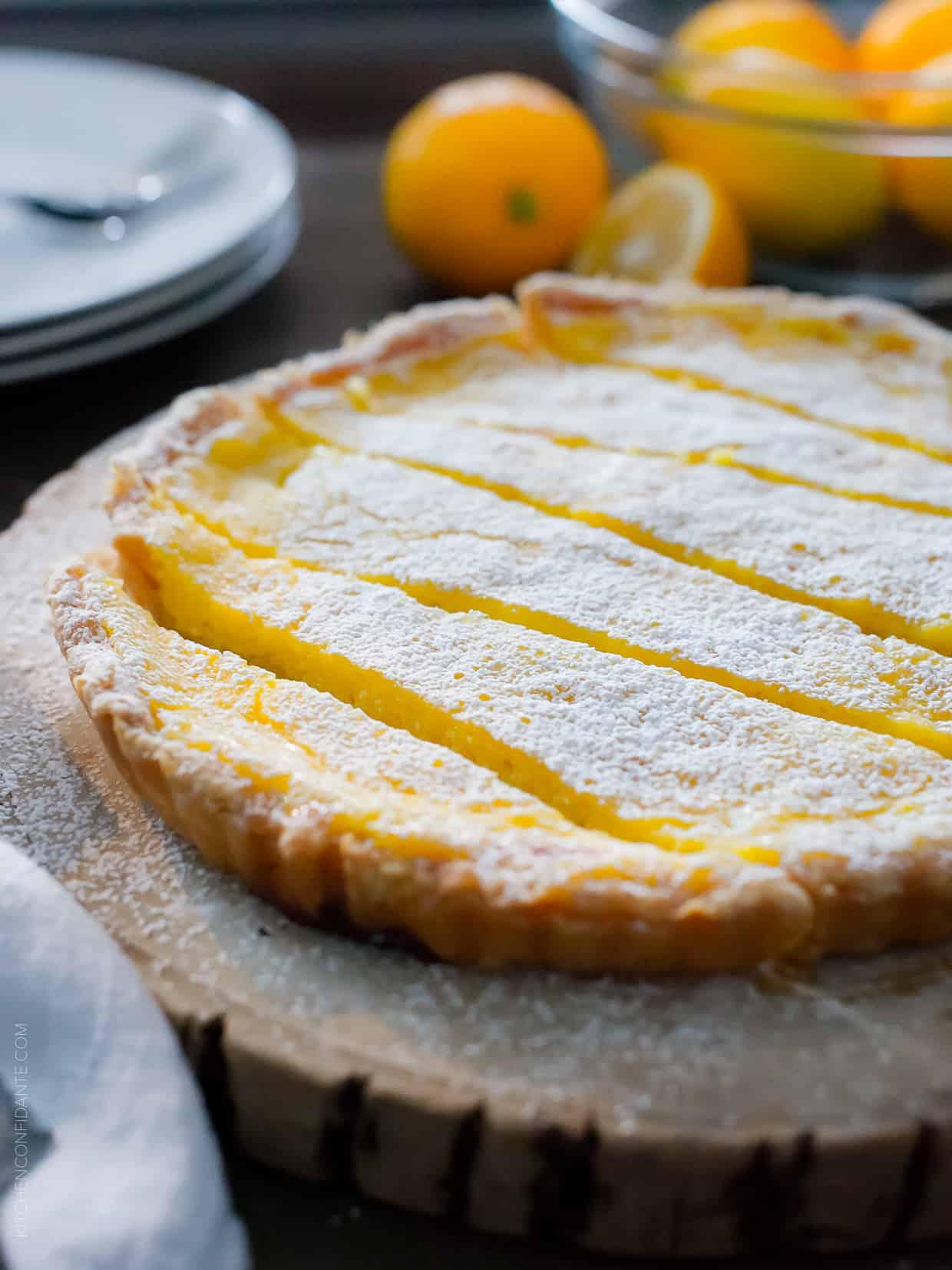 A Meyer Lemon Tart sliced on a serving platter.