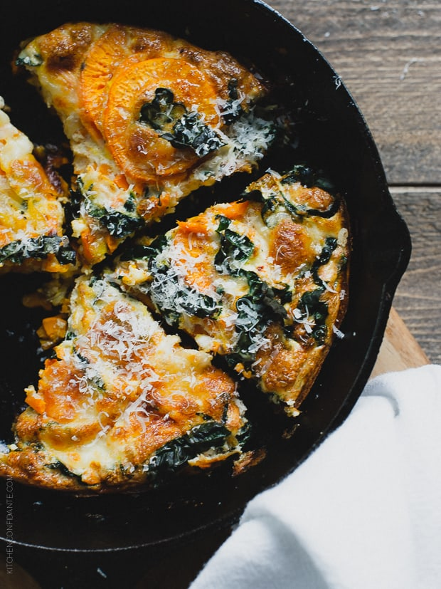A sliced frittata in a cast iron skillet.