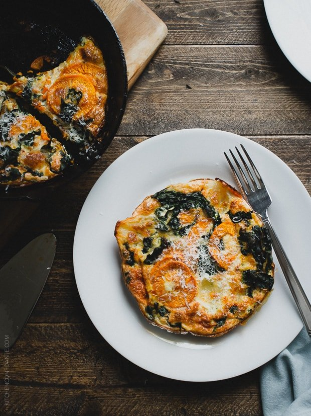 Spiralized Sweet Potato Kale Egg White Frittata on a white plate with a fork.