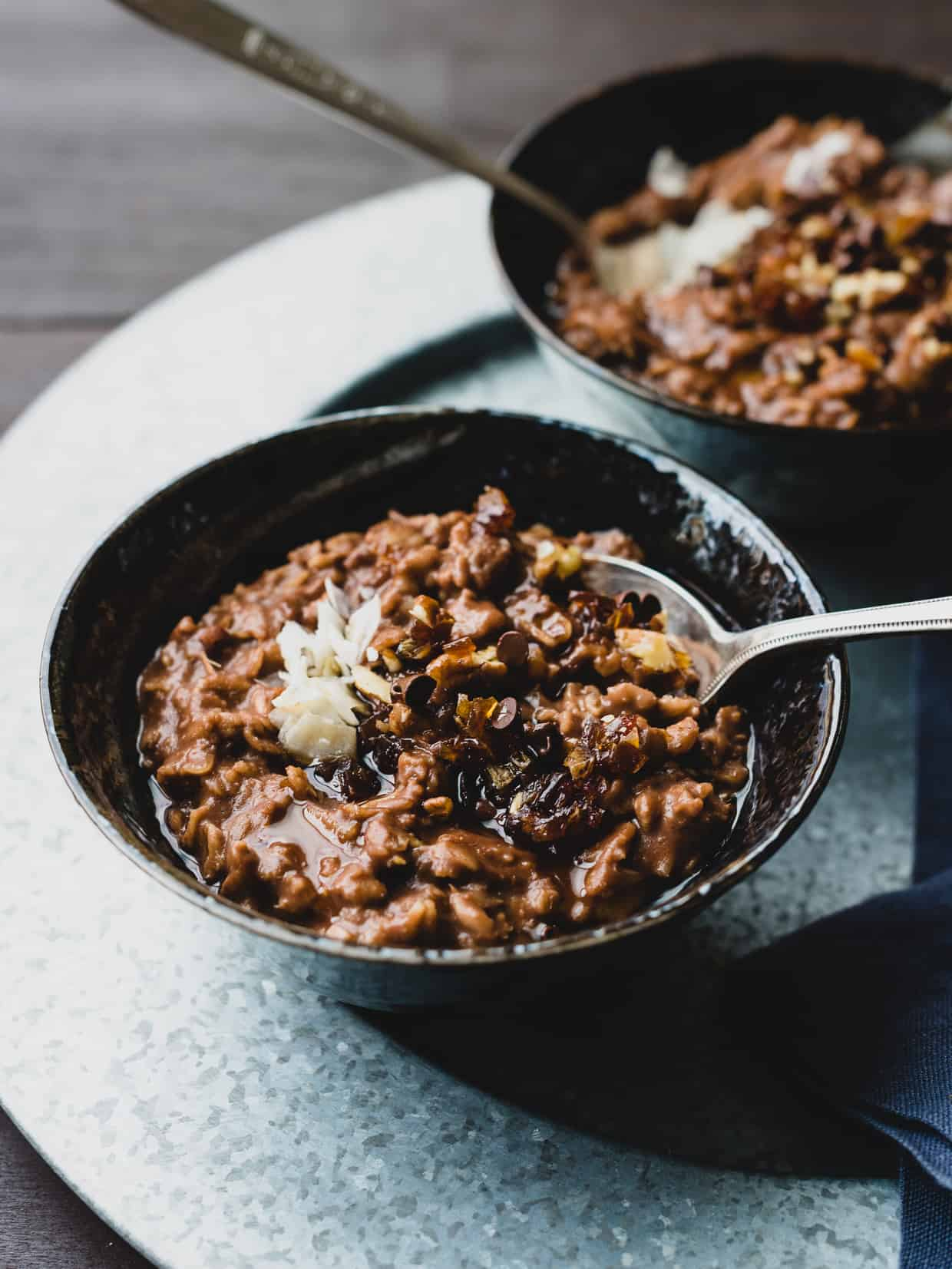 A bowl of Chocolate Porridge topped with mini chocolate chips.