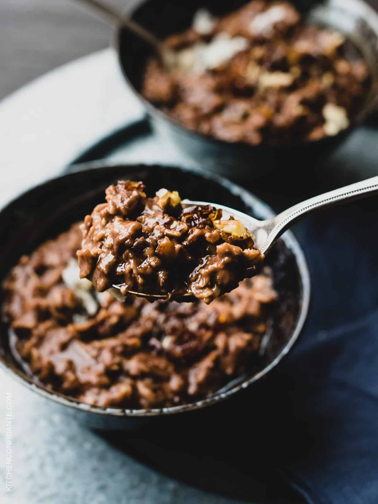 A closeup view of a spoonful of wholesome and delicious Chocolate Coconut Oat Porridge.