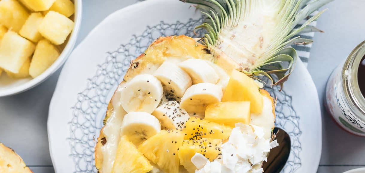 Pineapple Smoothie Bowl served in a pineapple.