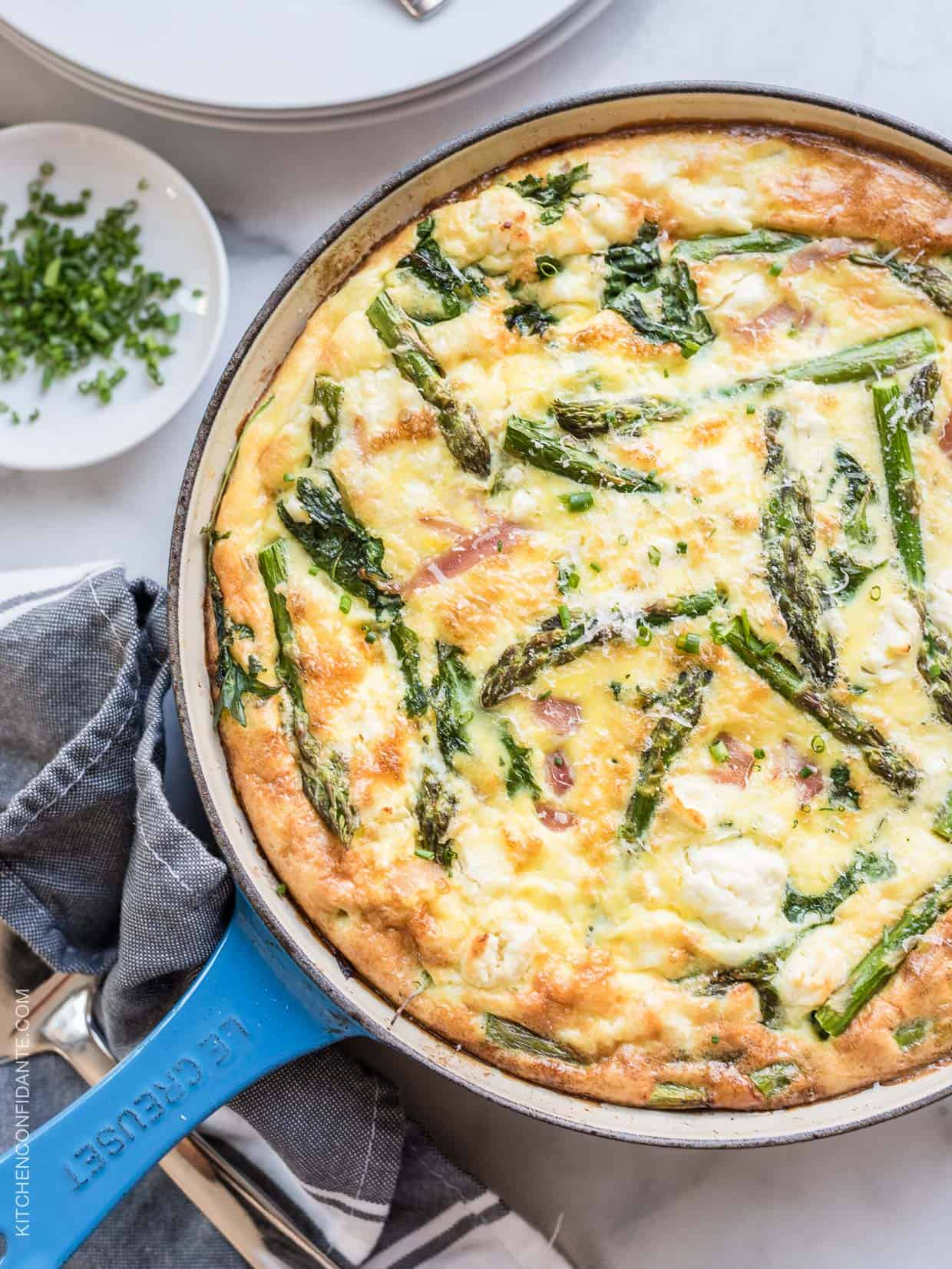 A view from the top of a freshly baked asparagus frittata.