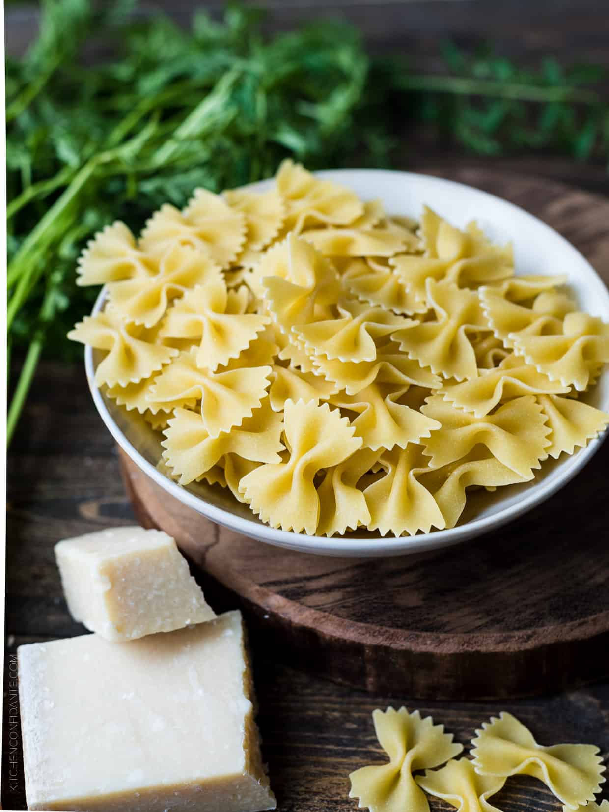 A bowl of dried farfalle pasta.
