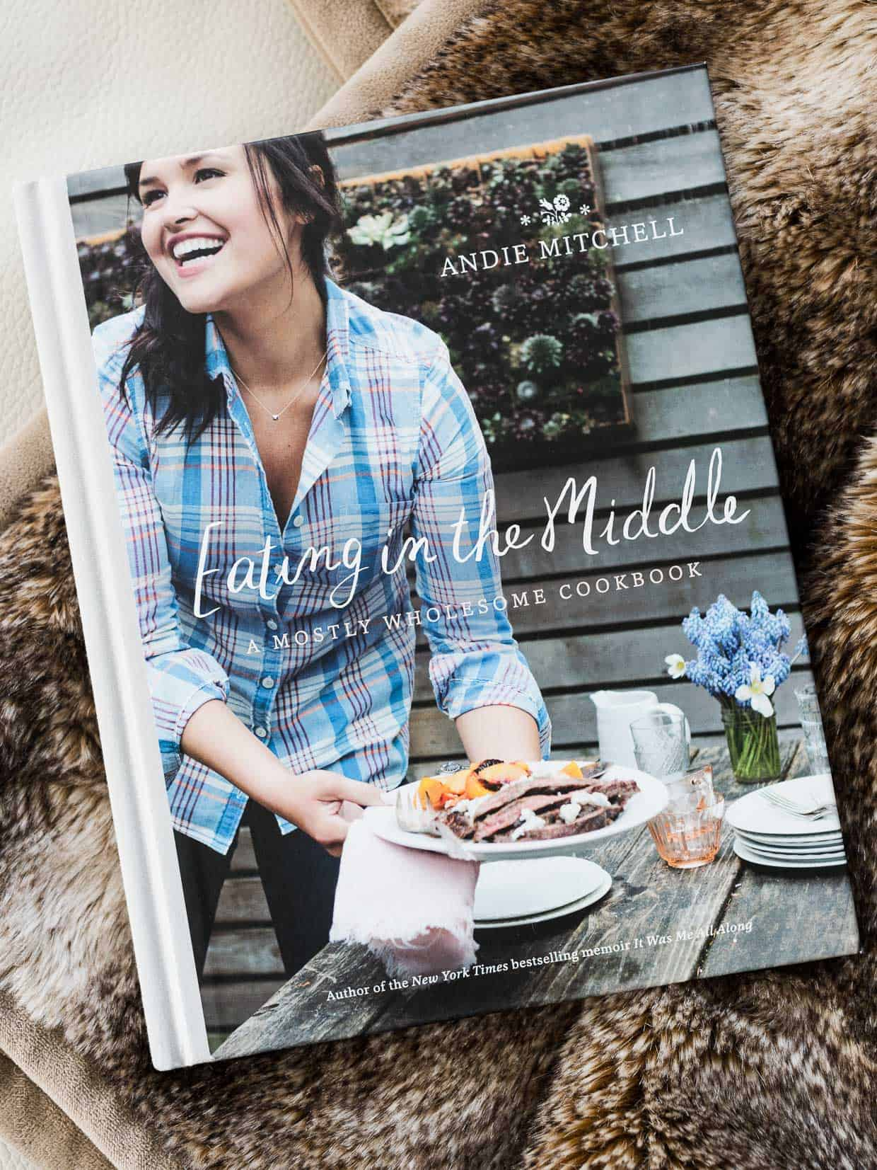 The book cover of Andie Mitchell's cookbook, Eating in the Middle.