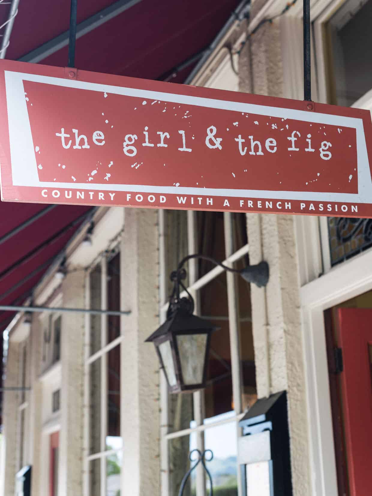 Outdoor signage at The Girl & The Fig.