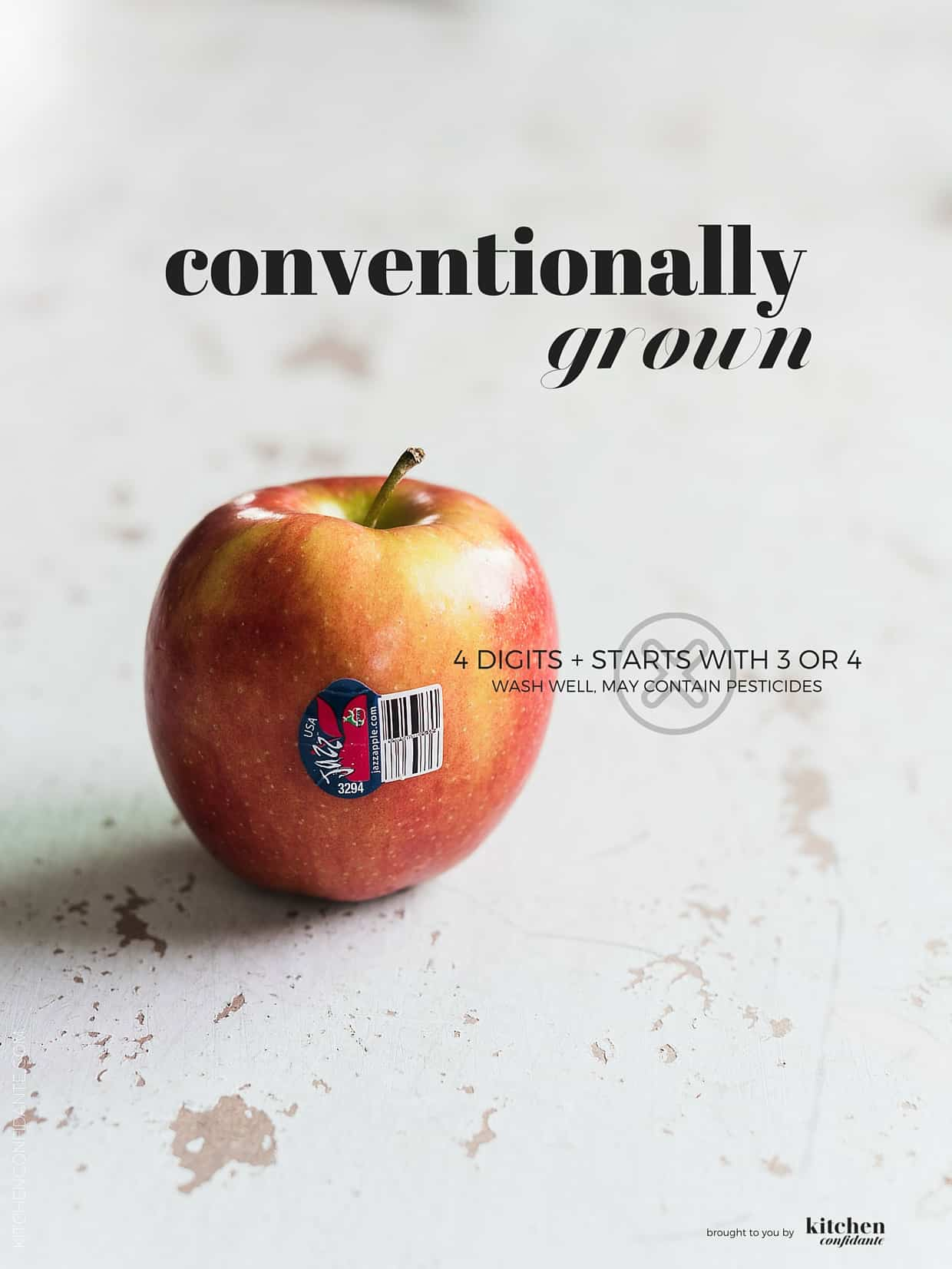 Fresh apple with conventionally grown PLU code on label.