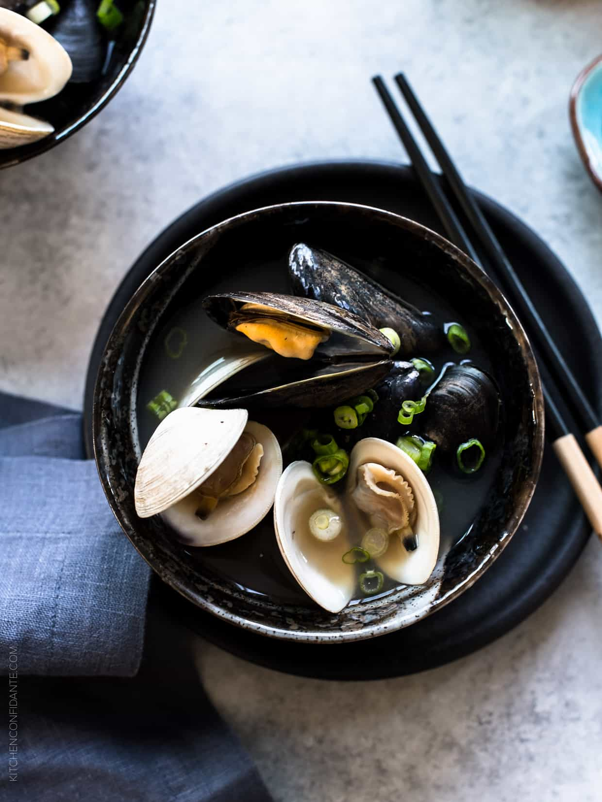 Clams and mussels opened in a bowl of Clam and Mussel Miso Soup.