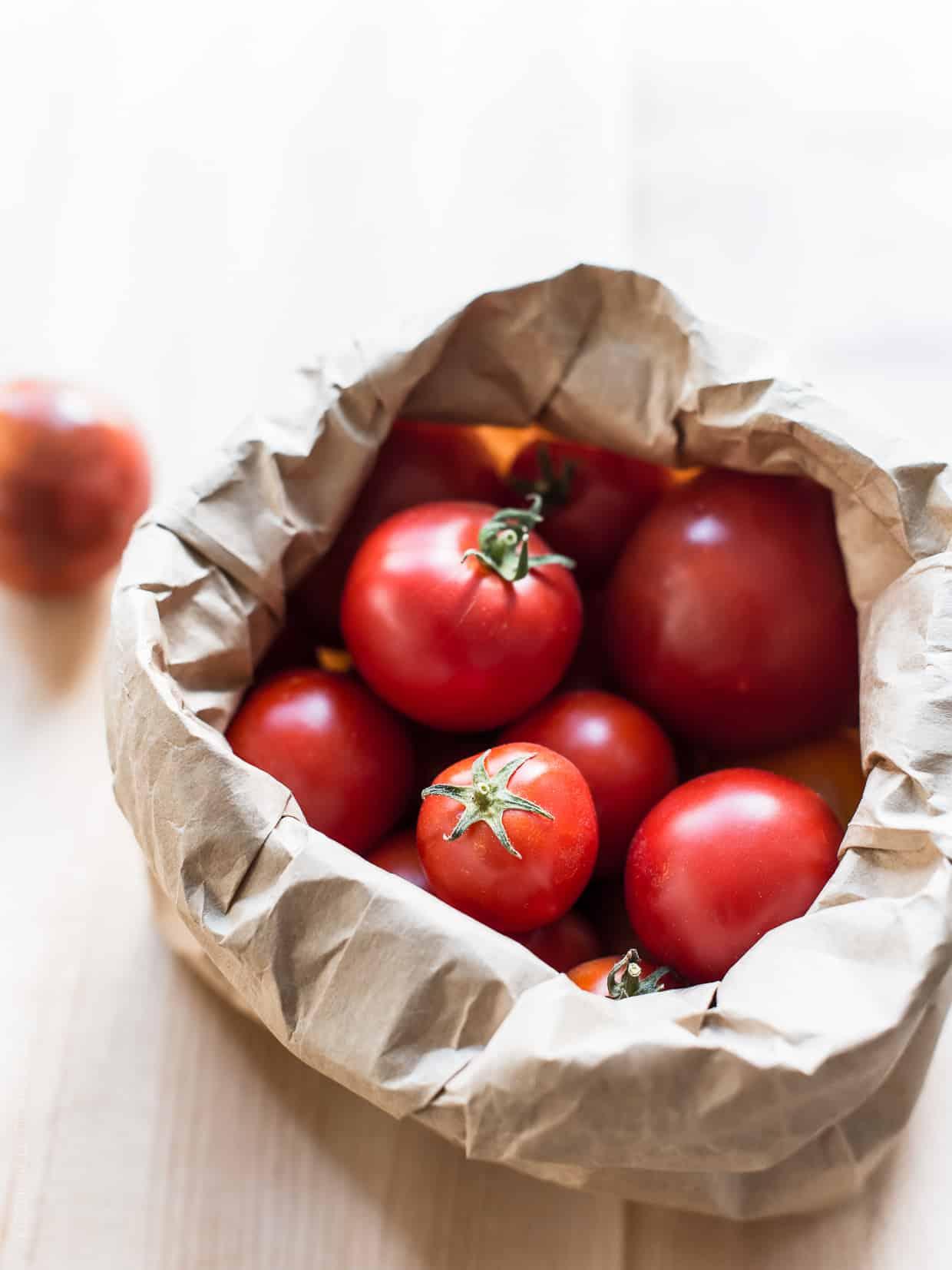 Fresh Heirloom Tomatoes in a paper sack.