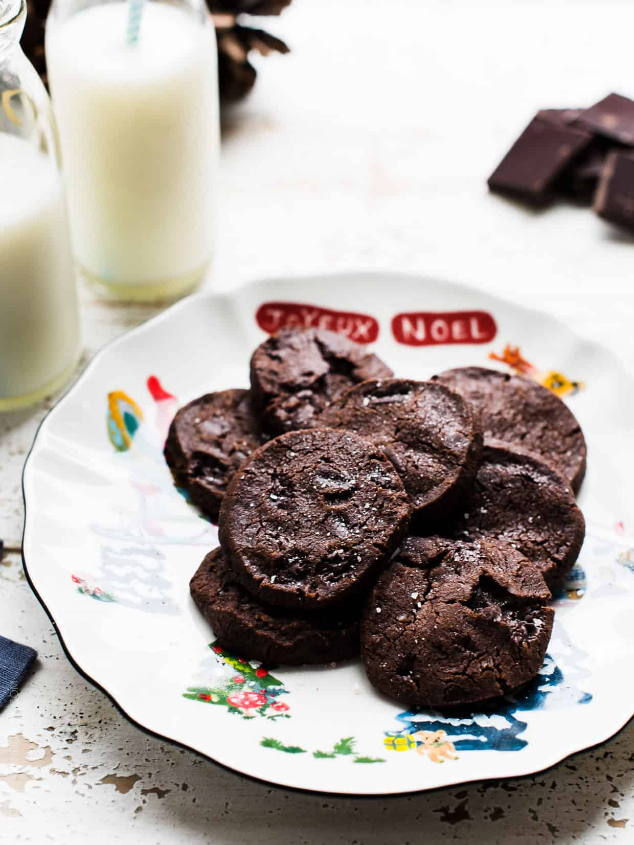 Dorie Greenspan's World Peace Cookies on a Christmas plate with milk.
