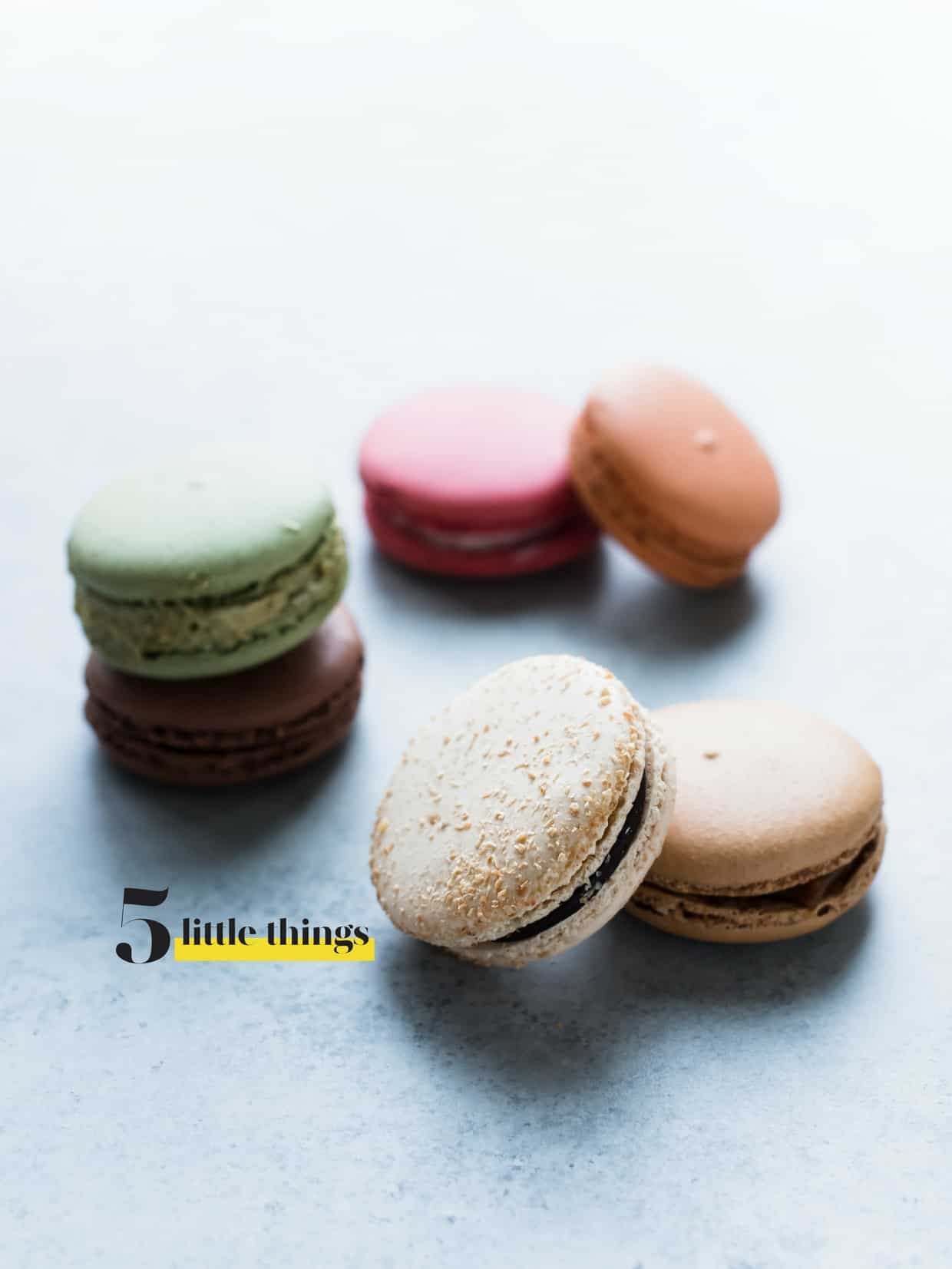 Selection of macaron cookies arranged on a counter top.