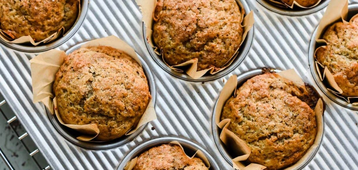 Applesauce Chia Muffins in a muffin tray.