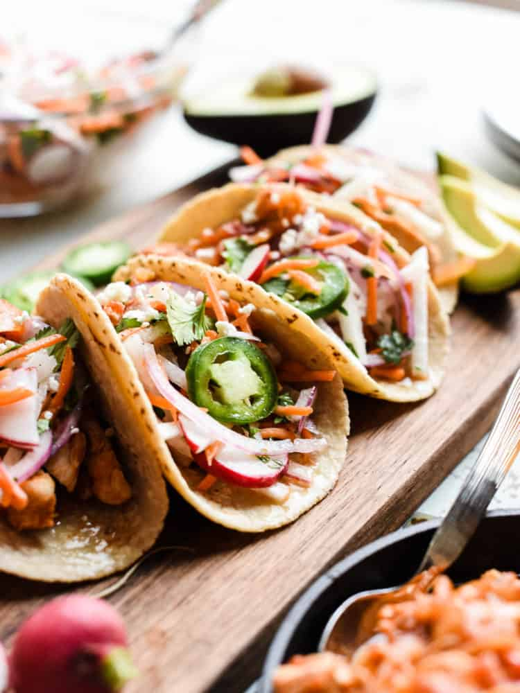 Chipotle Chicken Tacos on a wooden board.