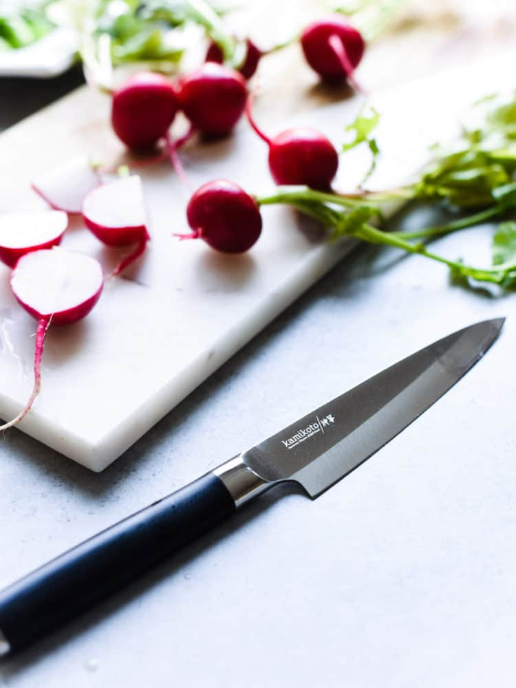 Kamikoto knife used to prepare a Miso-Marinated Steak Salad with a Miso-Ginger Dressing.