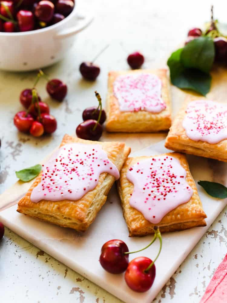 You'll never be able to buy pop tarts again after try these easy homemade cherry pop tarts! This recipe has a buttery crust and delicious homemade filling!