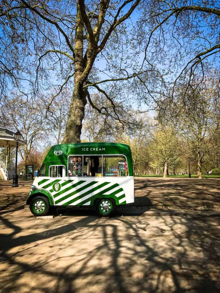 Green and white striped ice cream truck in Hyde Park, London.