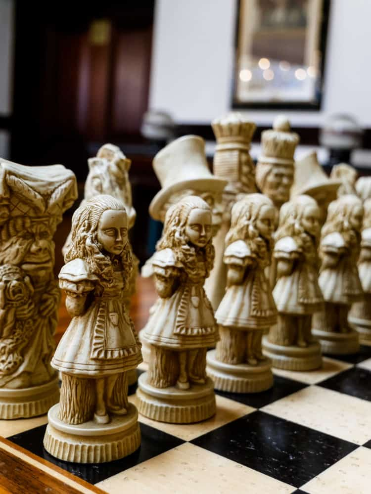 Carved chess pieces on a chessboard.